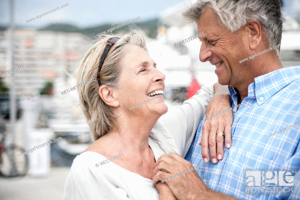 Stock Photo: Spain, Senior couple at harbour.