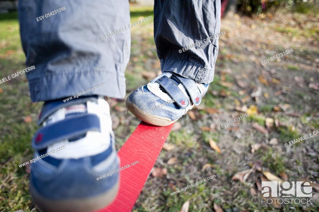 Stock Photo: child's feet on the slackline.