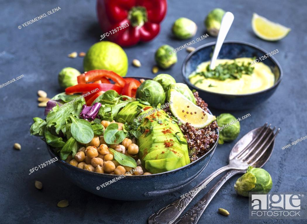 Stock Photo: Buddha bowl with chickpea, avocado, quinoa seeds, red bell pepper, fresh spinach, brussels sprout, lime mix.