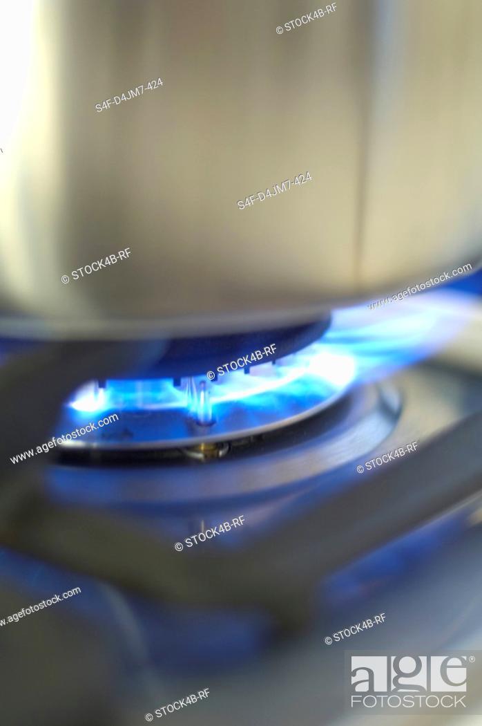 Stock Photo: Pot on gas stove.