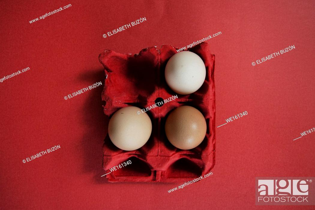 Stock Photo: Carton red with eggs brown.
