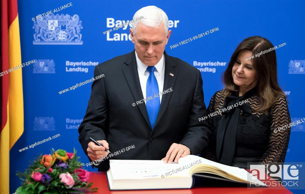 Stock Photo: 15 February 2019, Bavaria, München: Mike Pence, Vice President of the USA, and his wife Karen sign the Golden Book in the State Parliament before the award of.