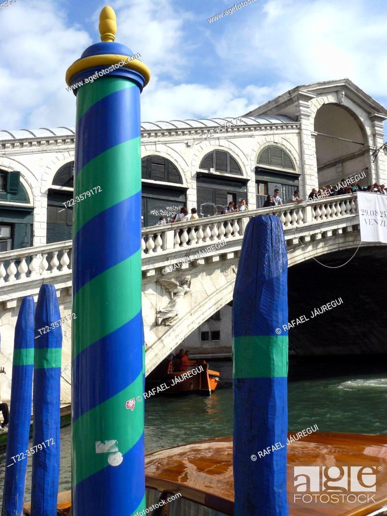 Stock Photo: Venice (Italy). Mooring piles next to the Rialto Bridge in the city of Venice.