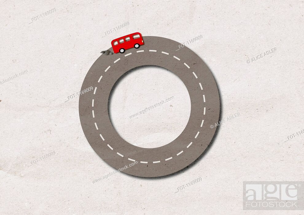 Stock Photo: A bus with smoke coming from exhaust driving on street shaped like a circle.