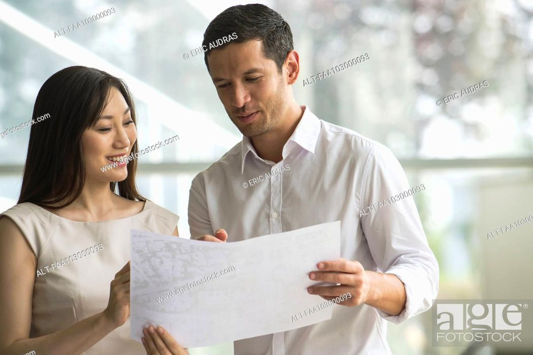 Stock Photo: Business associates collaborating.