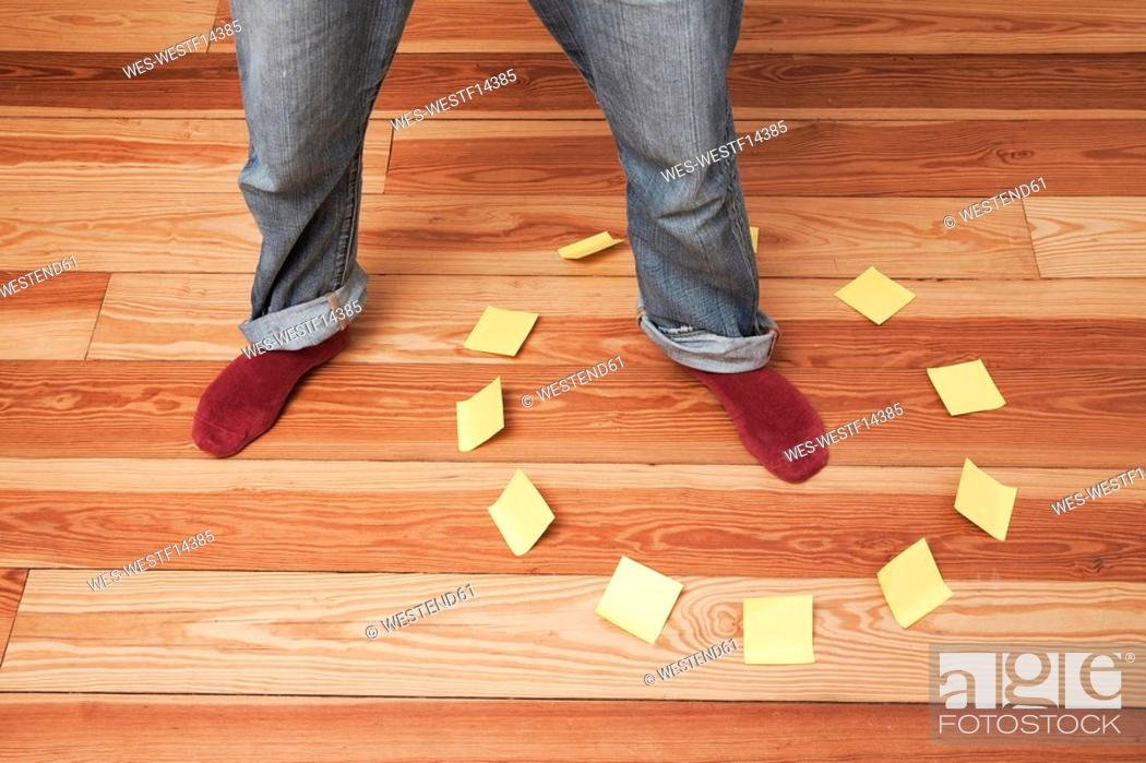 Stock Photo: Man foot in circle of adhesive notes.
