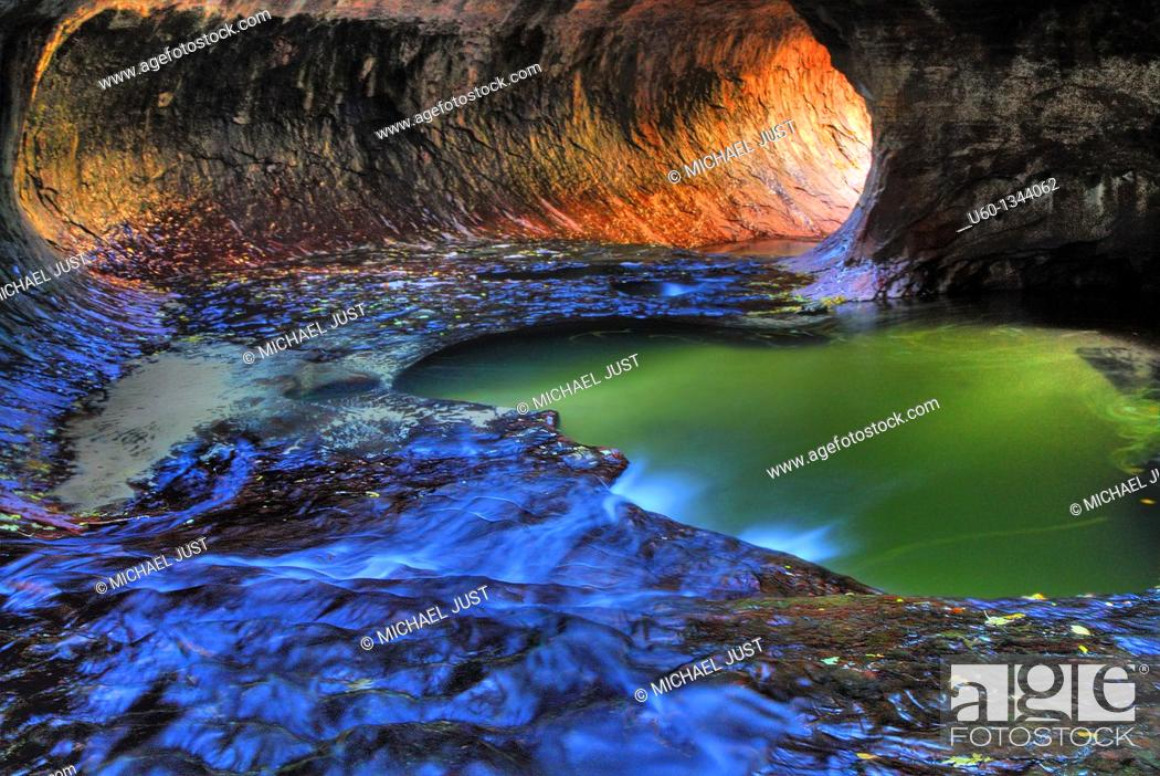 Stock Photo: Water flows from the Left Fork of North Creek through the pools at 'The Subway' during autumn at Zion National Park.