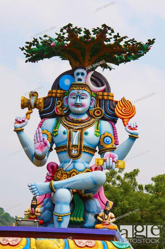 Stock Photo: Colorful idol of Lord Shiva, on the way to Kanchipuram, Tamil Nadu, India.