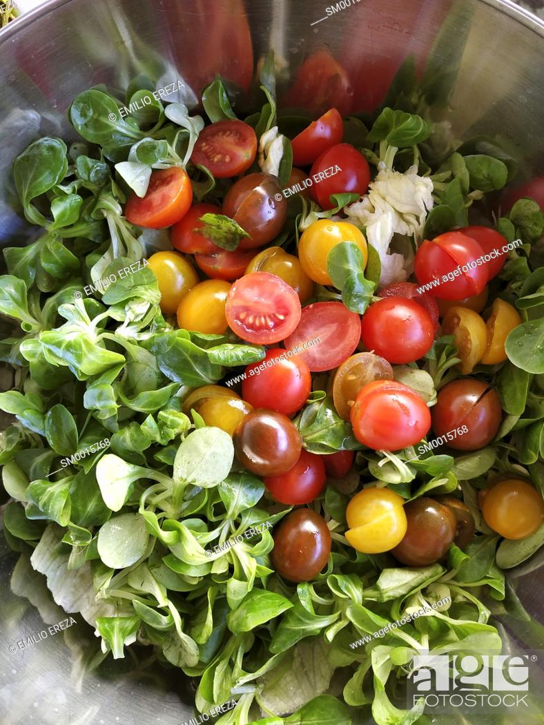 Stock Photo: Making salad.
