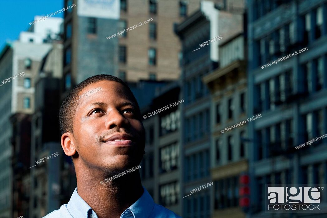 Stock Photo: Young man looking up.