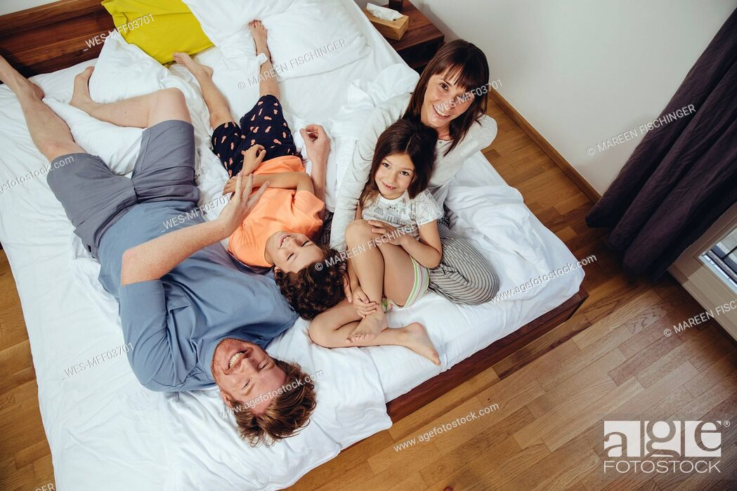 Stock Photo: Happy family in bed.
