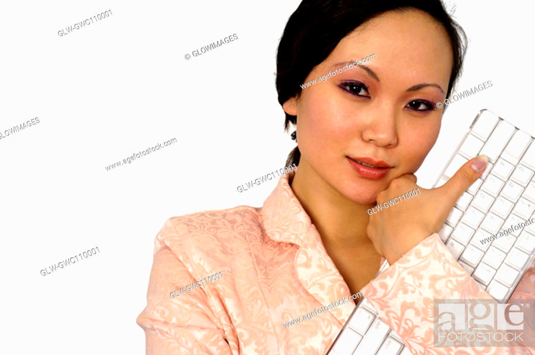 Stock Photo: Close-up of a businesswoman holding a computer keyboard.