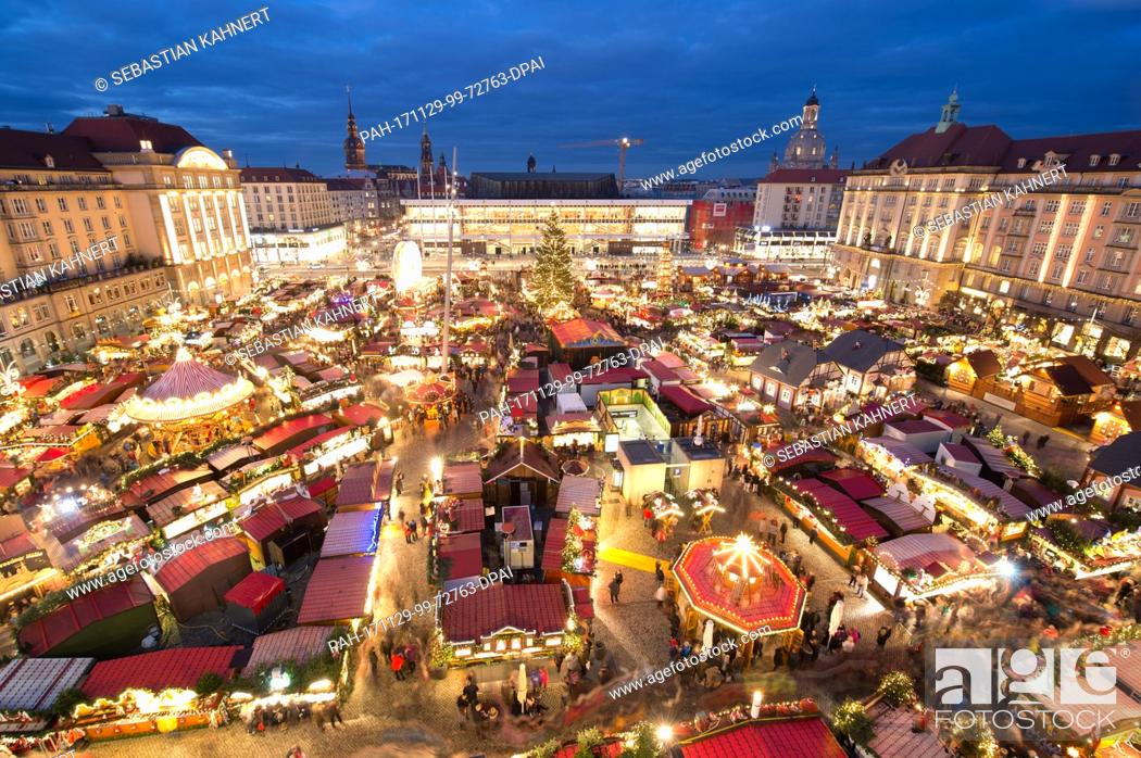 Stock Photo: View of the illuminated Striezel Market in Dresden, Germany, 29 November 2017. The Christmas market on the Old Market Square in Dresden is open until 24.
