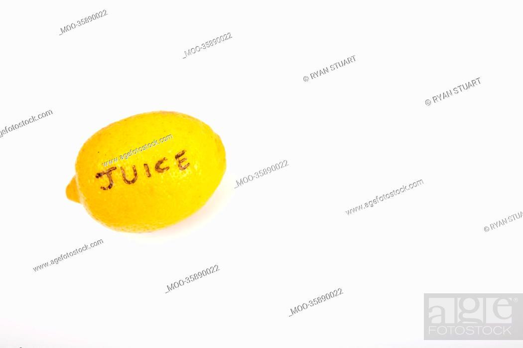 Stock Photo: Juicy lemon over white background.