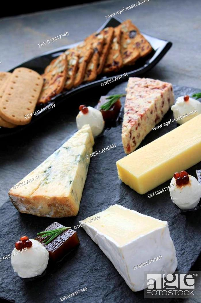 Stock Photo: cheese selection platter board.