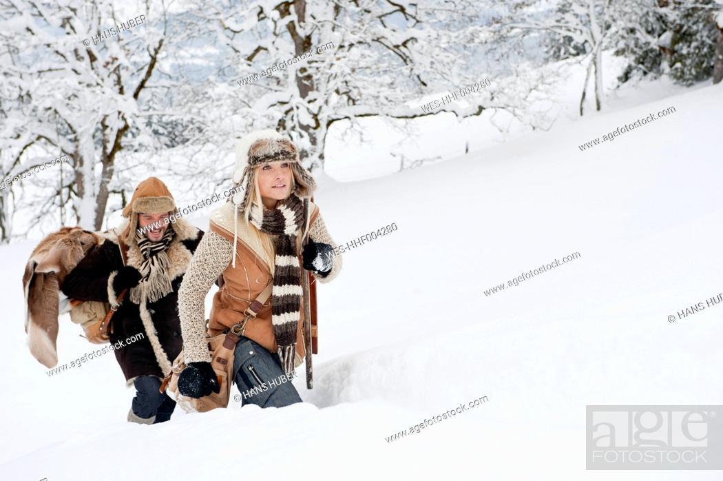 Stock Photo: Austria, Salzburg County, Couple walking through winter landscape, smiling.