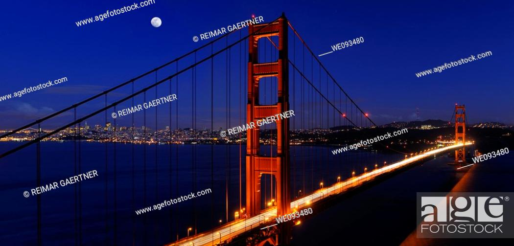 Stock Photo: Panorama of Golden Gate Bridge and San Francisco skyline at night with rising moon.