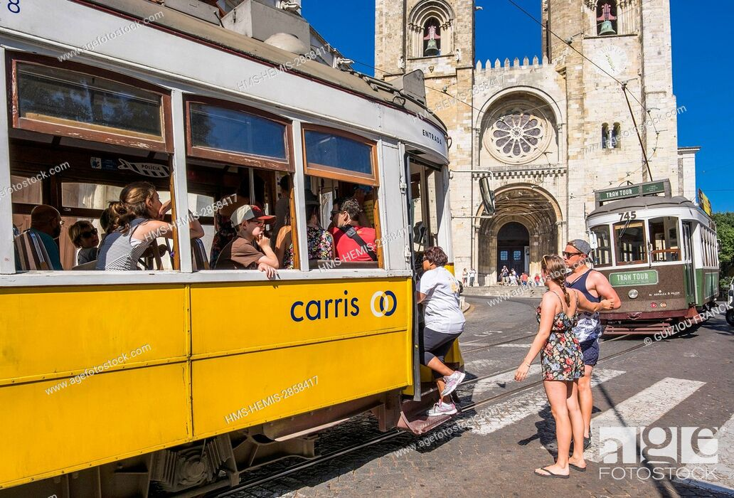 Stock Photo: Portugal, Lisbon, Alfama district, the tramway or eletrico in front of Santa Maria Maior cathedral.