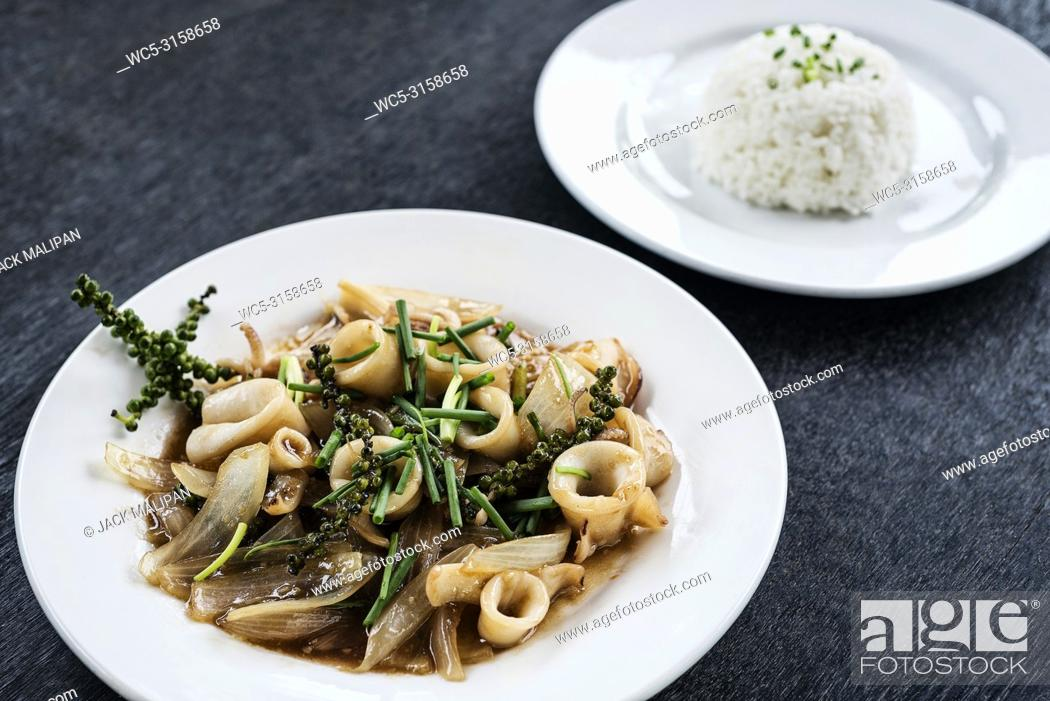Stock Photo: fresh squid and kampot green pepper stir fry traditional asian cambodian seafood meal.