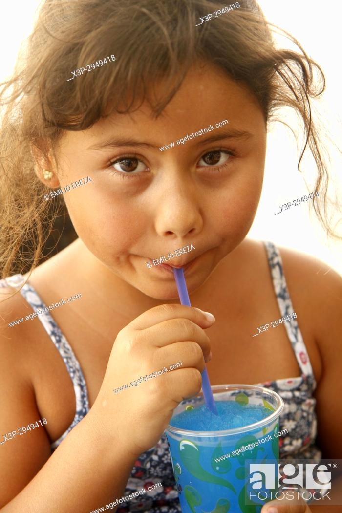 Stock Photo: Little girl eating an iced drink.