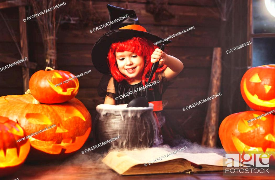 Stock Photo: Halloween. little witch child cooking potion in the cauldron with pumpkin and spell book.