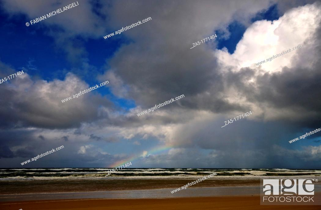 Stock Photo: Rainbow at Seventy Five Mile Beach  Fraser Island, Great Sandy National Park, Queensland, Australia.