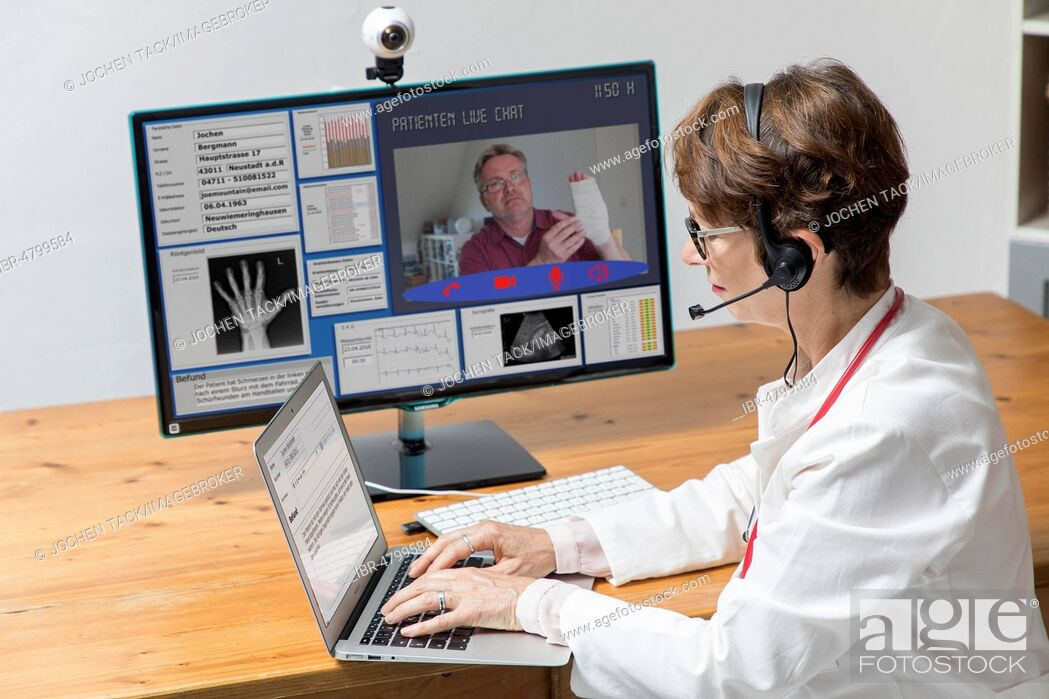 Stock Photo: Symbol photo for telemedicine, doctor in a practice, communicates with the patient via a webcam, patient data and findings on the monitor, Germany.