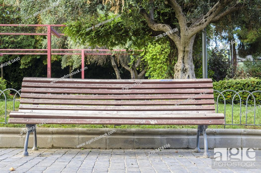 Stock Photo: Madrid, Spain. View of a bench in a park closed to Chamberi quarter, Madrid city, Spain.