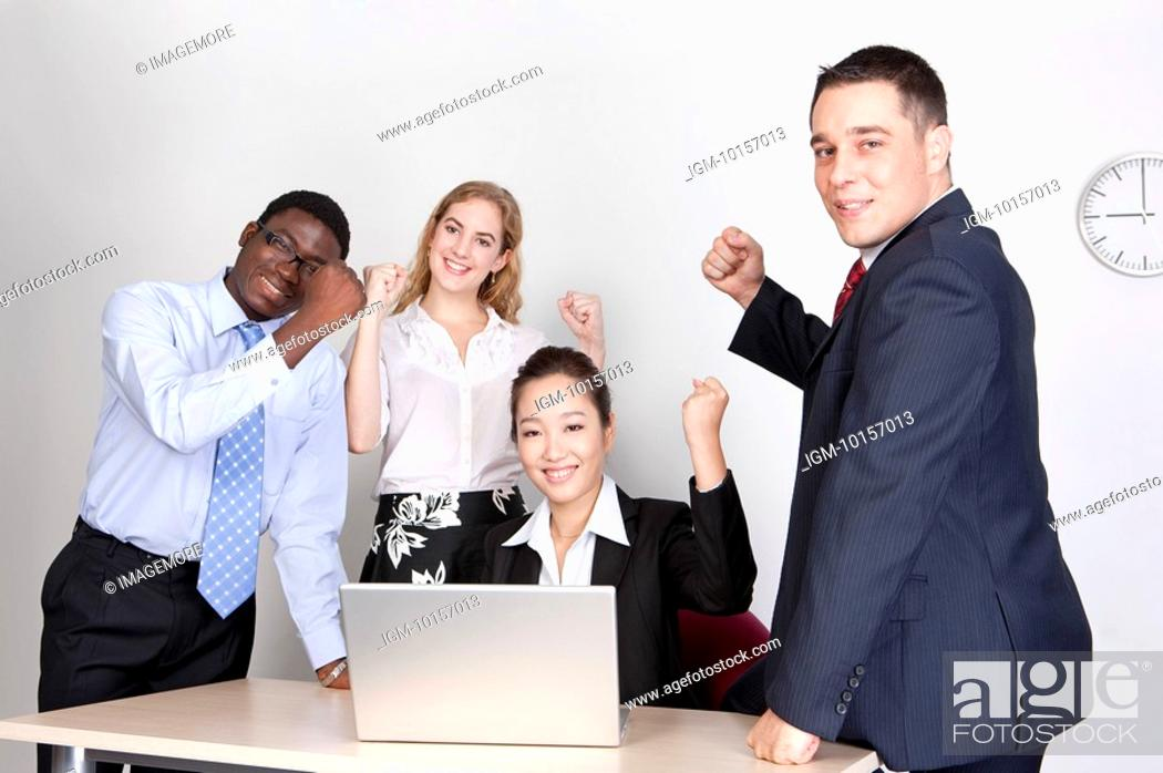 Stock Photo: Business people holding fists, encouraging each other and smiling at the camera.