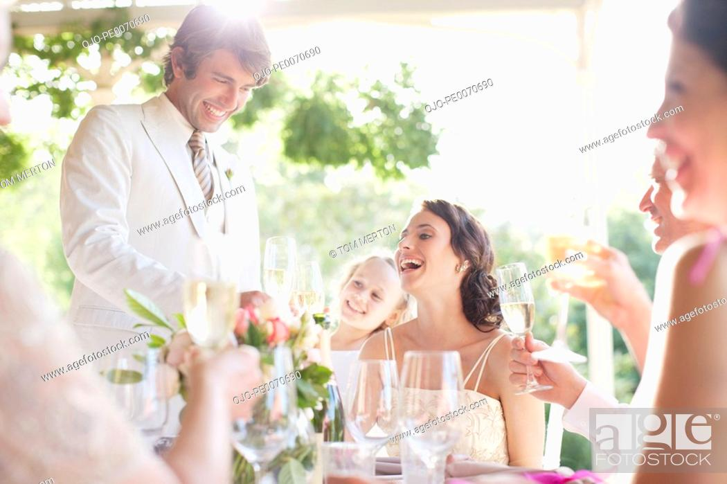 Stock Photo: Groom giving toast at wedding reception.