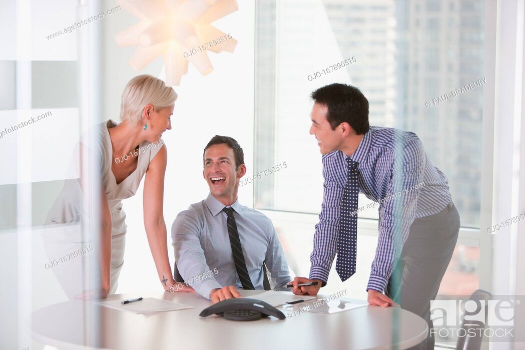 Stock Photo: Business people talking in office.