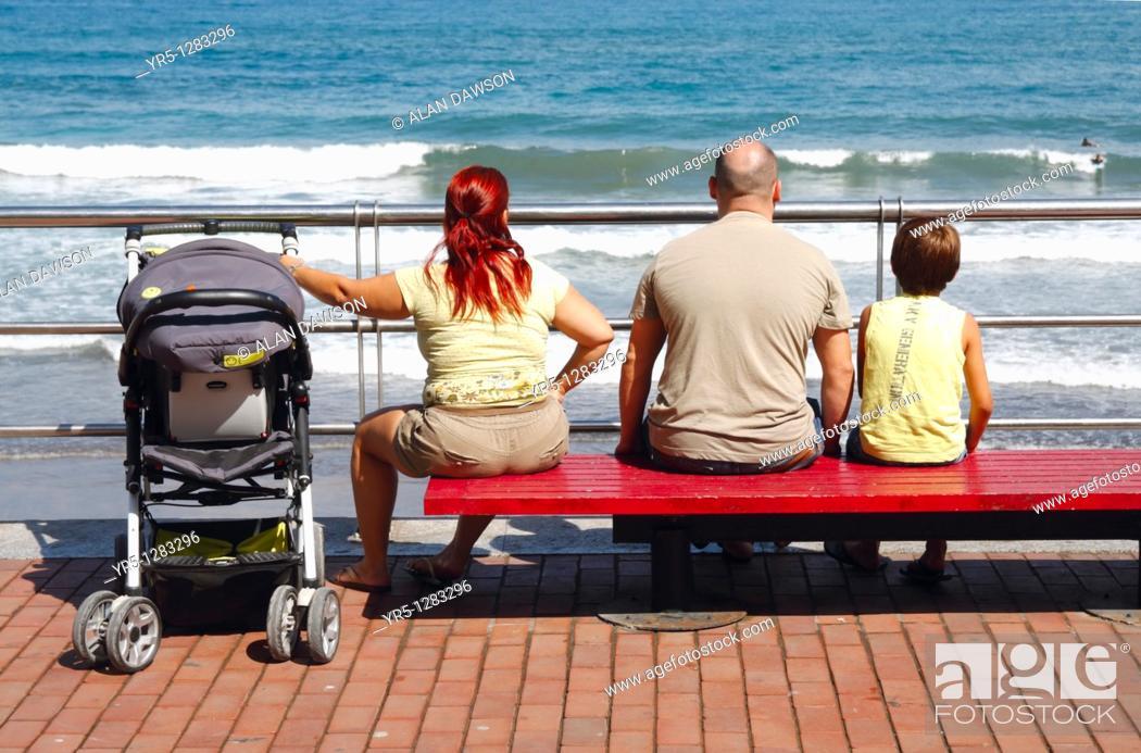 Stock Photo: Family watching surfers at Playa de Las Canteras, Las Palmas, Gran Canaria, Canary Islands, Spain.
