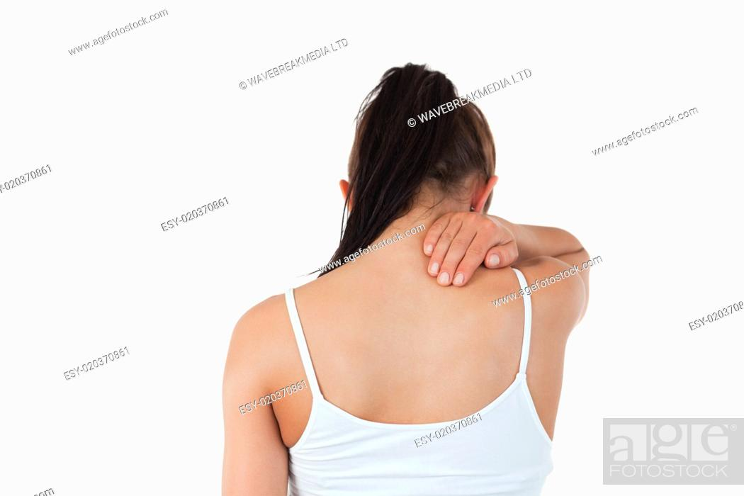 Stock Photo: Back view of woman with pain in her neck.
