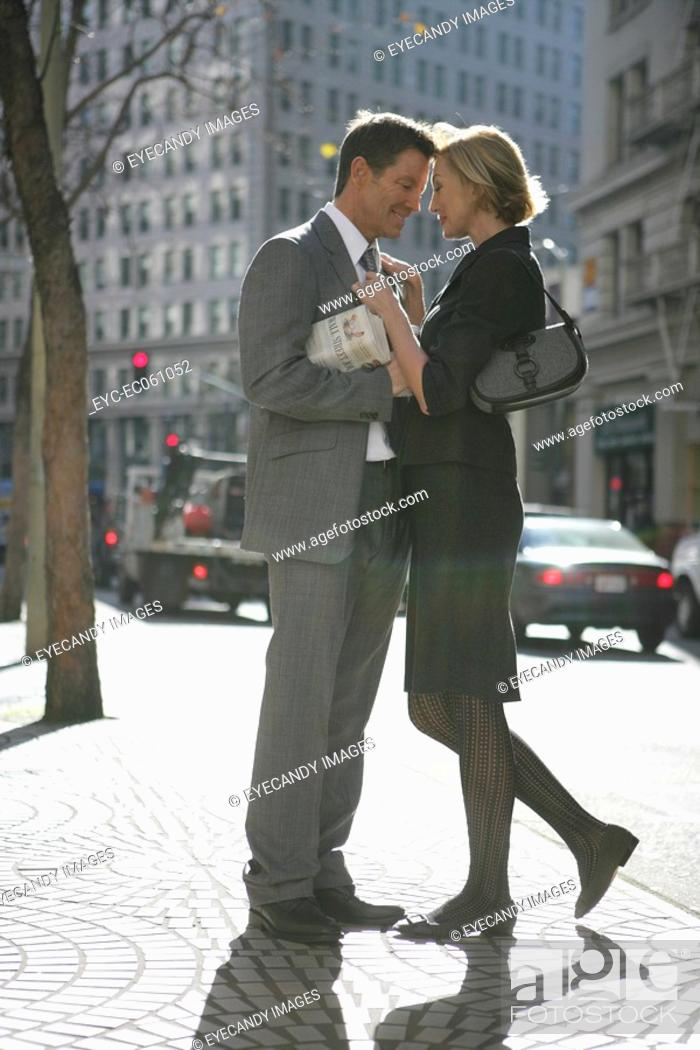 Stock Photo: Couple standing in the street together.