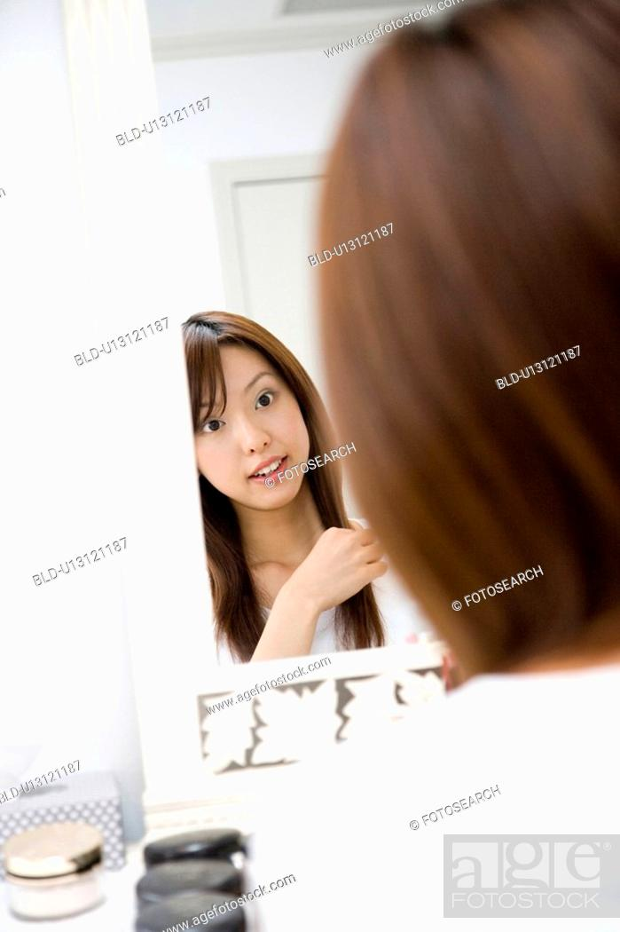 Stock Photo: Woman before the dresser.