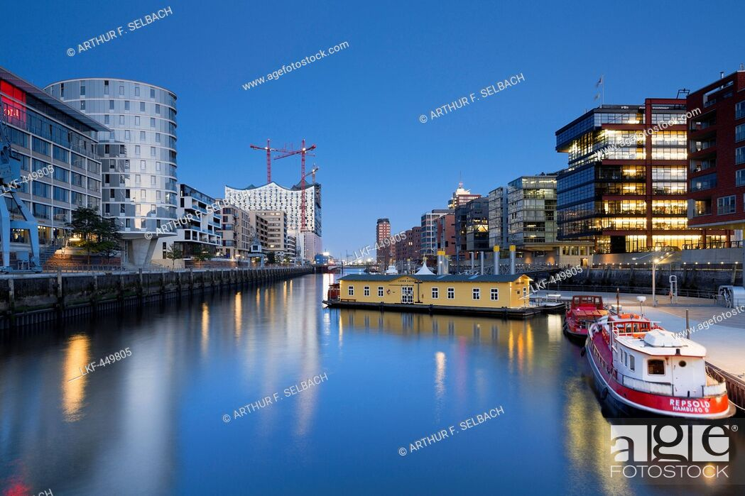 Stock Photo: View to Sandtor harbour in the evening light with Sandtorkai on the right and Kaiserkai on the left with the Elbphilharmonie, Hafencity, Hamburg, Germany.