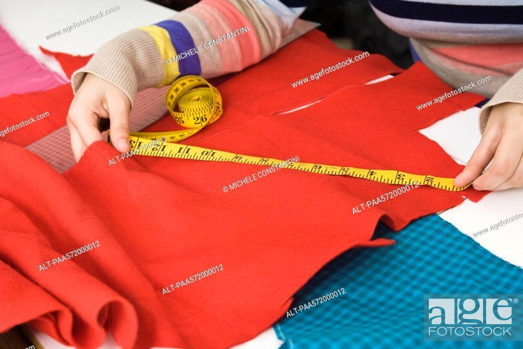 Stock Photo: Measuring fabric.