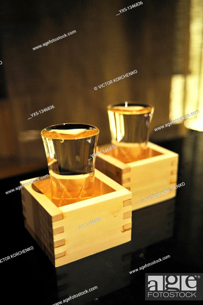 Stock Photo: Full sake cups in wooden boxes on a table in a restaurant in Tokyo.