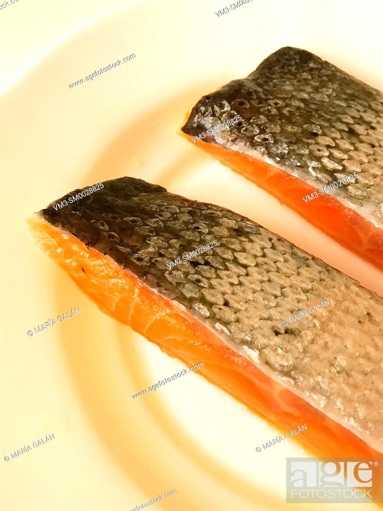 Stock Photo: Two salmon loins in a dish.