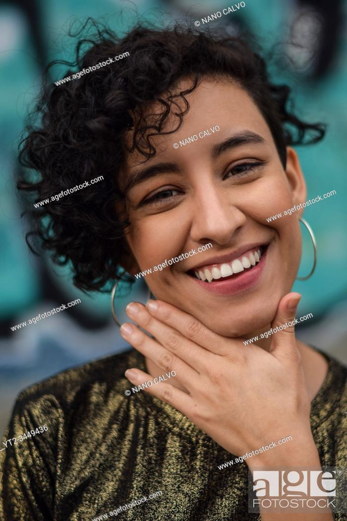 Stock Photo: Smiling young latina woman looking at camera, Cali, Colombia.