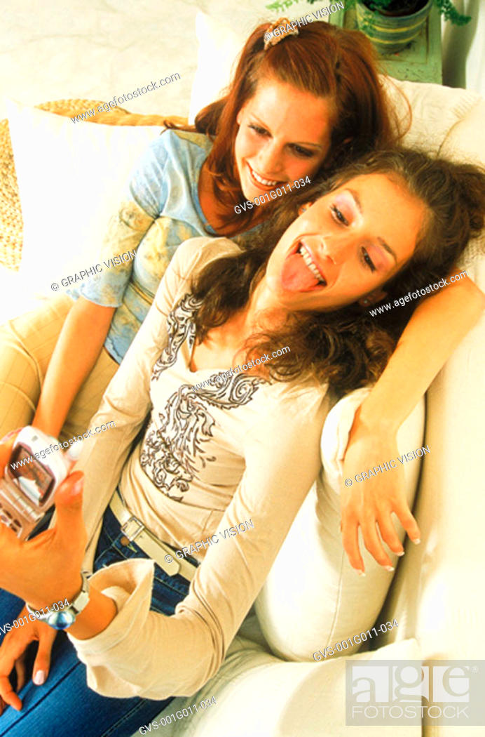 Stock Photo: Two young women holding a mobile phone.