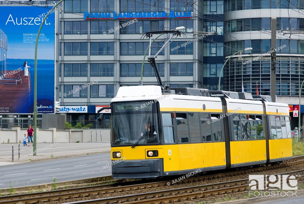 Stock Photo: Modern tram on the streets of the former East Berlin with new buildings in background.