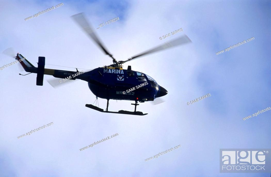 Stock Photo: Mexican Navy helicopter flying in the sky, Cancún, Quintana Roo, Yucatán Peninsula, Mexico.
