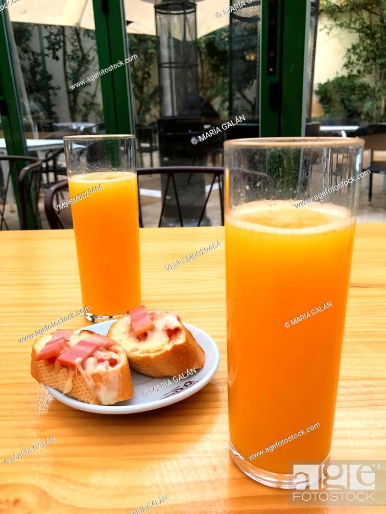 Stock Photo: Two glasses of orange juice in a terrace.