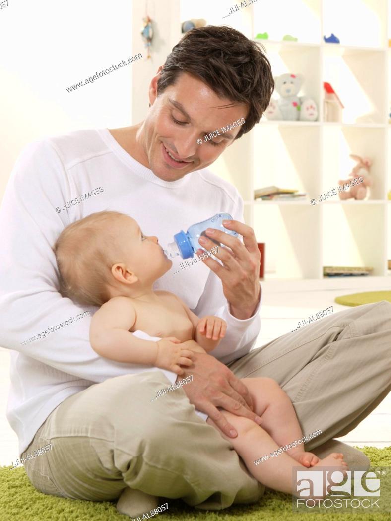 Stock Photo: Father feeding baby.
