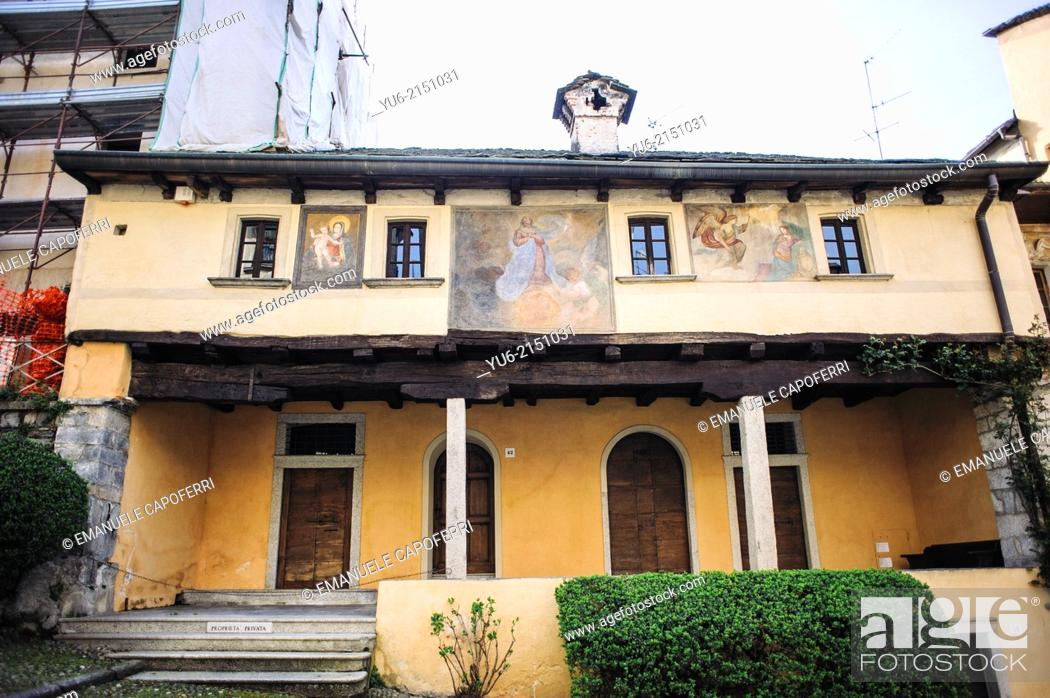 Stock Photo: Casa dei Nani ('House of the dwarves') called for small windows, village of Orta, Lake Orta, Piedmont, Italy.