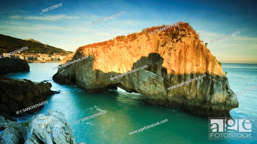 Stock Photo: Sunrise at Isla de los Conejos, Castro Urdiales, Cantabria, Spain.