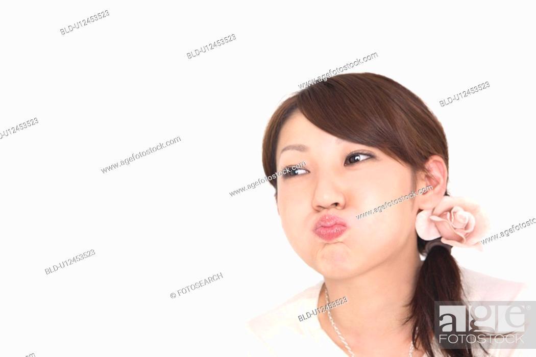 Stock Photo: Woman pouting.