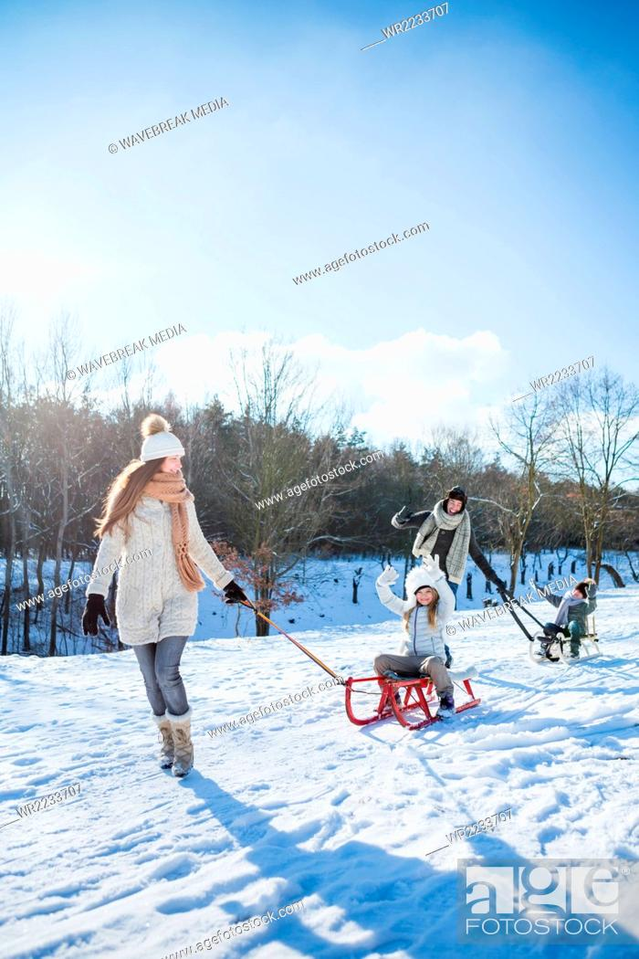 Stock Photo: Family playing with sled.