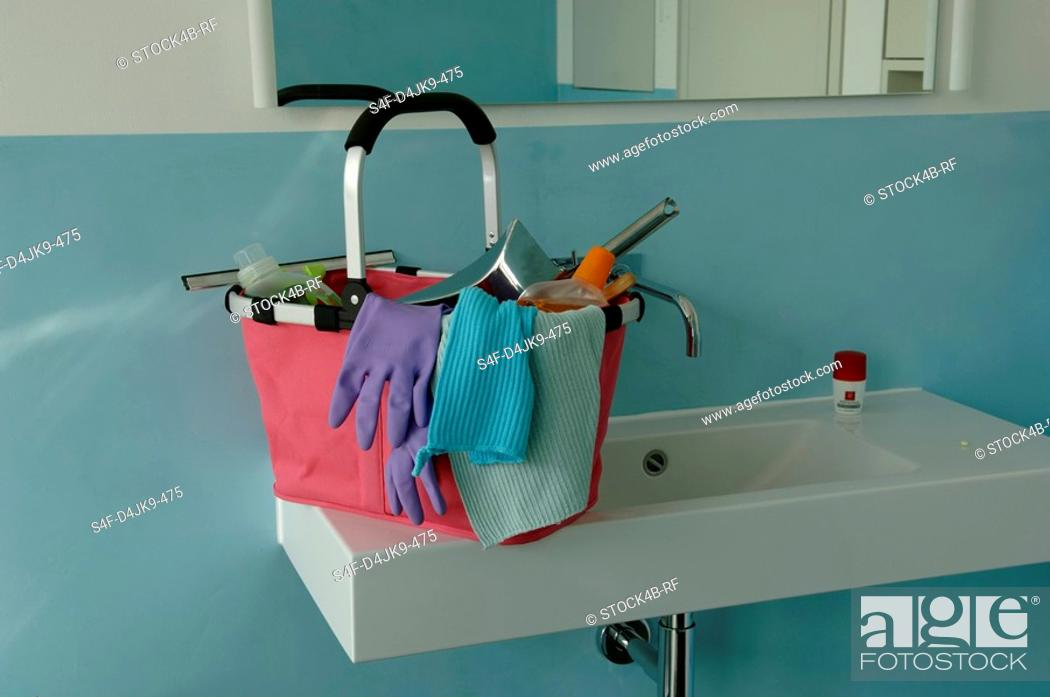 Stock Photo: Bucket with cleaning utensils on the brim of a washbasin.